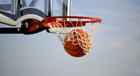 ball point: Action shot of basketball going through basketball hoop and net