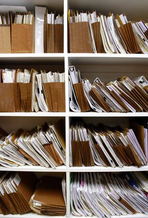 Office shelves full of files and boxes Stock Photo - 3633336