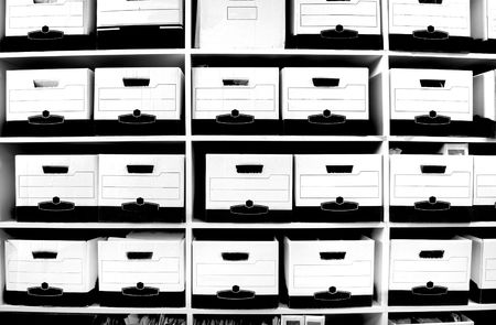 storage boxes: Office shelves full of files and boxes Stock Photo