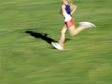 Runner running a race around a track with  lines photo