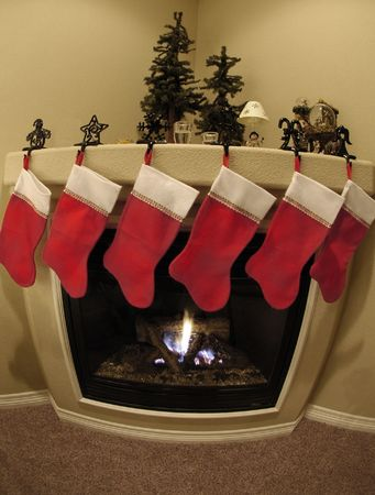 christmas sock: Front room decorated for christmas with christmas stockings and fireplace Stock Photo