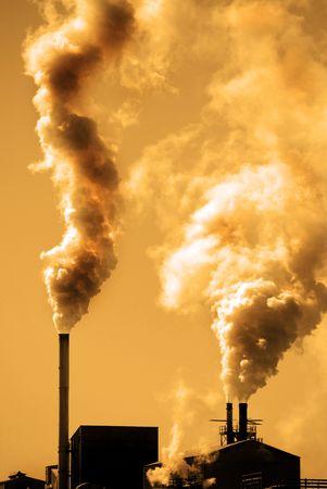 Factory smokestacks polluting the air