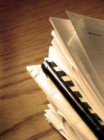 Desk with files and papers stacked on it Stock Photo - 3839355