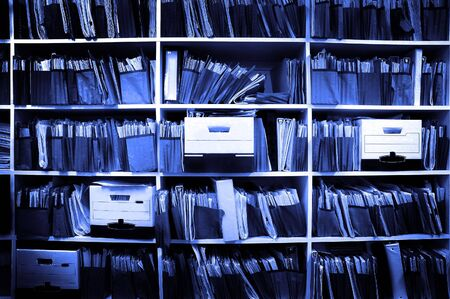 Office shelves full of files and boxes Stock Photo - 3839373