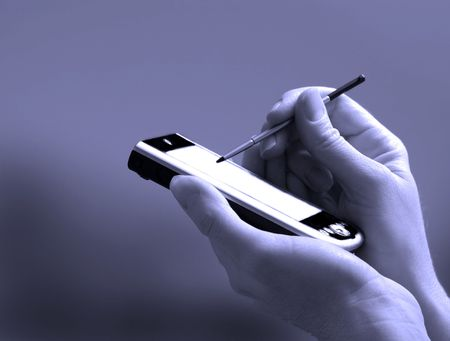 stylus: Person holding a pda handheld device with stylus