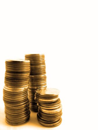 Several stacks of pennies isolated on white background Imagens
