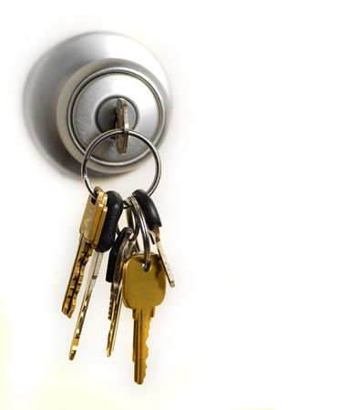 golden key: Keys in lock hanging from door knob Stock Photo