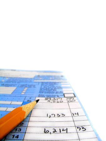 Detail closeup of current tax forms and caculator