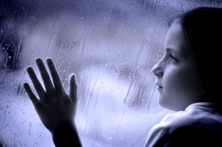 windows and doors: Girl looking out window on a rainy day