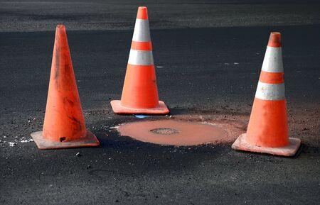 roadwork: Roadwork with Orange Pile On Markers in the Street
