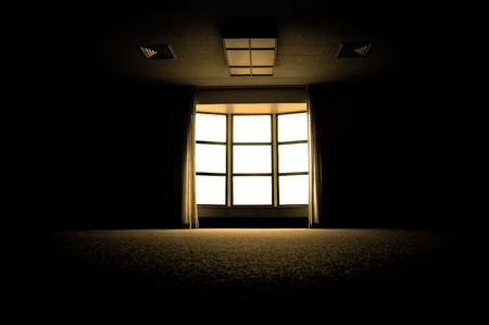 Large dark room with bright light coming in through paned window  Stock Photo - 4246773