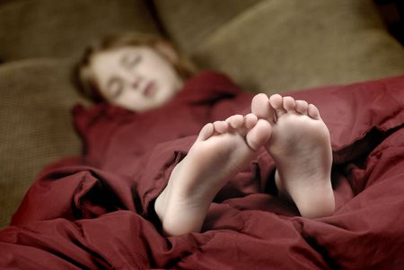 big toe: Little girl sleeping with feet poking out of blankets