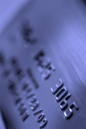 Closeup of credit card showing numbers and colors