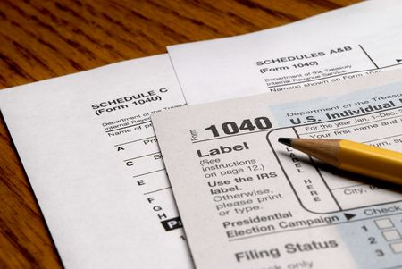 figuring: Detail closeup of current tax forms and pencil Stock Photo