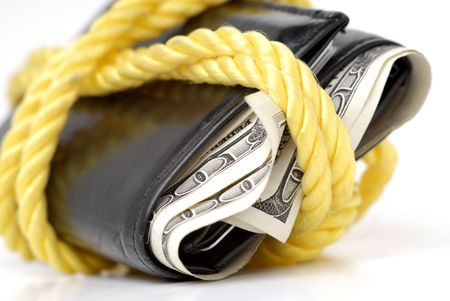 bulging: Closeup of hundred dollar bills in bulging wallet tied with rope