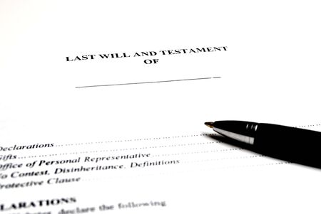 gifting: Pen laying on top of a Will for estate planning