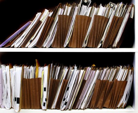 pile of papers: Office shelves full of files and boxes Stock Photo
