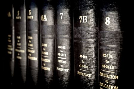 law: Close up of several volumes of law books of codes and statutes Stock Photo