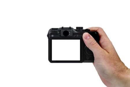 looking at camera: Hand holding point and shoot camera isolated on white background