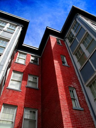luxury apartment: Rows of Apartment Buildings with Blue Sky in Background Stock Photo