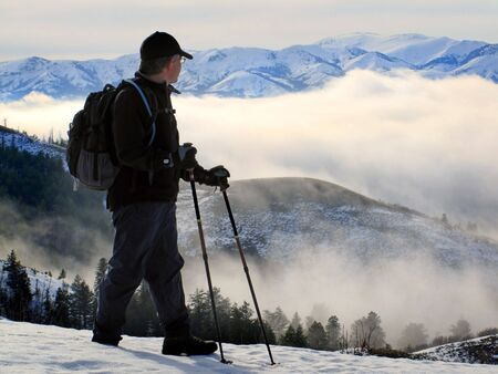 stepping: One person walking with valley and fog with mountains in background
