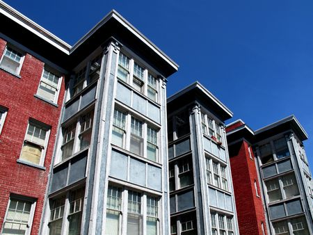 Rows of Apartment Buildings with Blue Sky in Background photo