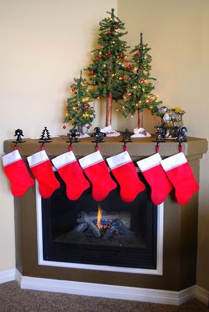 livingroom: Front room decorated for christmas with christmas stockings and fireplace Stock Photo
