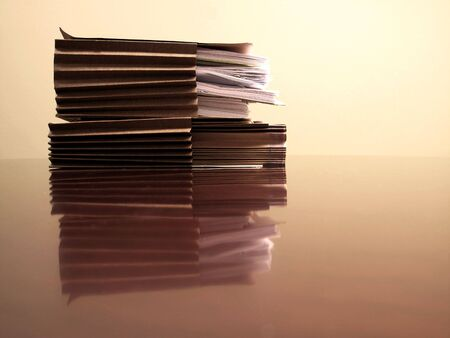 Office desk with files papers and pen Stock Photo - 6154439