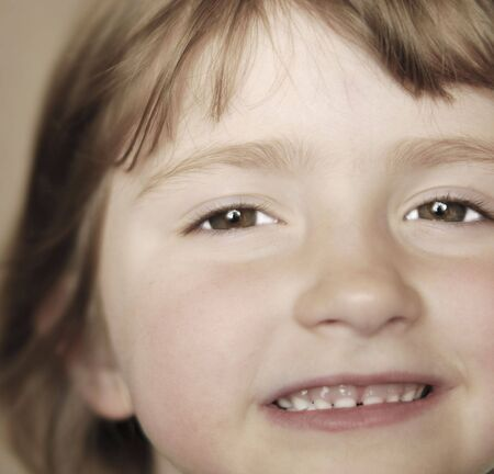 Portrait of young little girl with focus on eyes photo