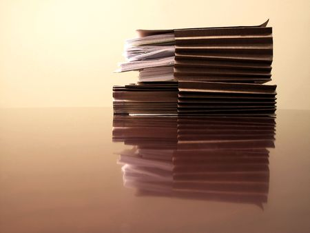 worked: Office desk with files papers and pen Stock Photo