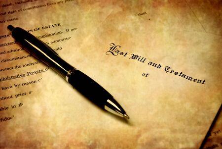 estate planning: Pen laying on top of a Will for estate planning