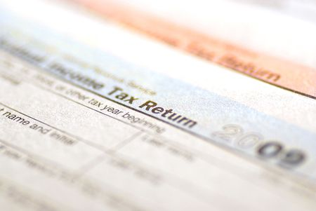 Detail closeup of current tax forms for IRS filing photo