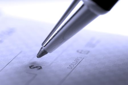 Person writing check with pen and checkbook photo