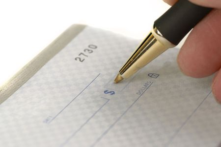 person writing: Person writing check with pen and checkbook