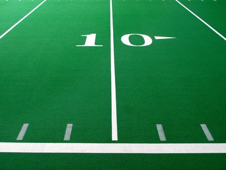 yardline: Football field with green turf and white yardlines and markers