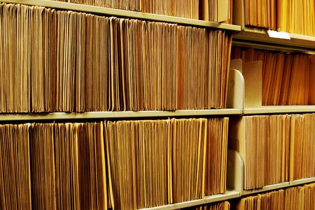 legal document: Shelf full of folders and files in an office