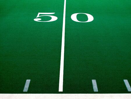 Fifty 50 yard line on football field                 photo
