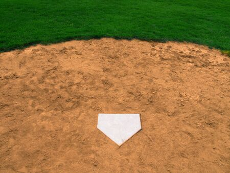 Home plate on baseball field with copy space photo