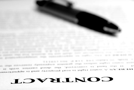 broken contract: Contract lying on desk with pen