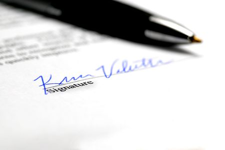 contractual: Contract with person signing name on signature line Stock Photo