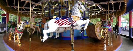Carousel at amusement park with rides for kids photo