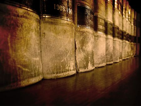 Row of old leather law books on a shelf