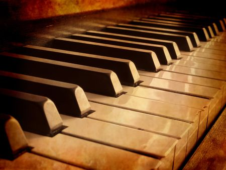 sheet music: Closeup of black and white piano keys and wood grain with sepia tone Stock Photo