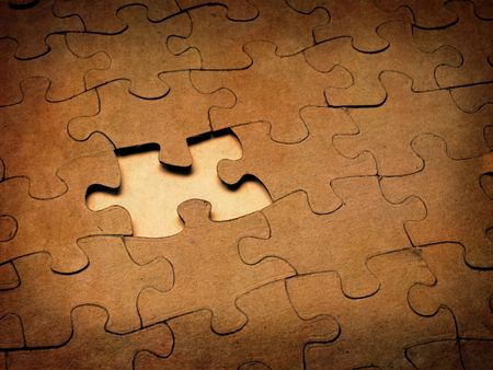 puzzle shape: Closeup of grainy puzzle pieces with one missing Stock Photo