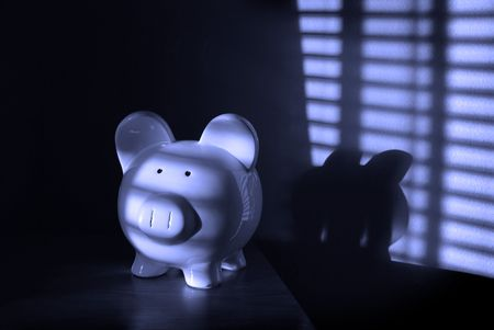 disciplined: Piggy Bank with light from blinds in background