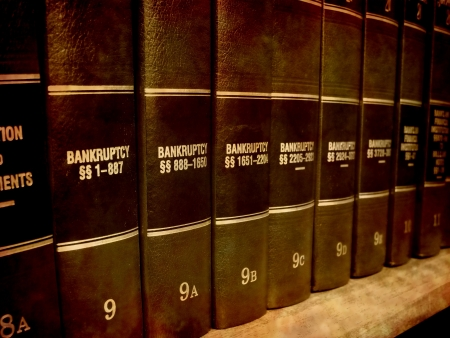 law: Close up of several volumes of law books of codes and statutes on bankruptcy