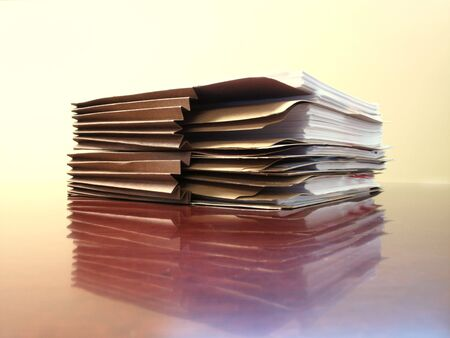 stack of papers: Office desk with files papers and folders Stock Photo