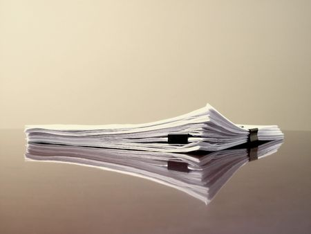 stack of documents: Office desk with files papers and clips