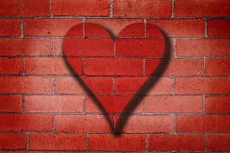 red wall: Old Red Brick Wall with Heart Graffiti Stock Photo