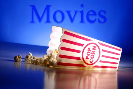 Popcorn for a movie in a popcorn holder and spilling out